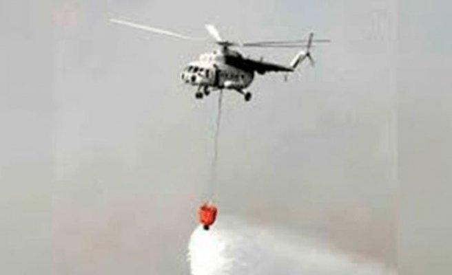 Güney'den gelen uçaklarla helikopter yangın söndürme çalışmalarına başladı